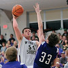 Teutopolis' Kyle Pruemer goes for a hook shot over Breese Central's Kyler Scheer in Greenville.