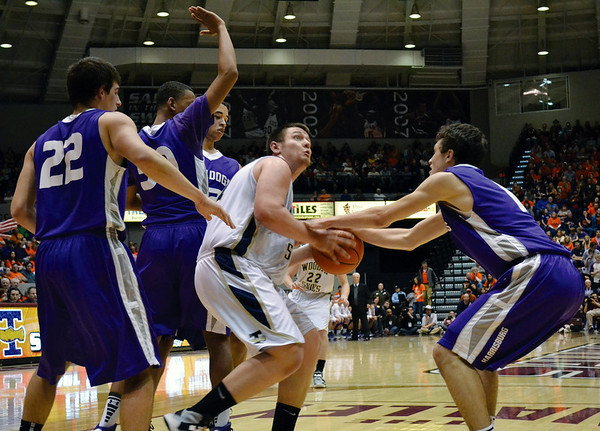 Teutopolis' Kyle Pruemer is surrounded and guarded by four players from Harrisburg High School at Southern Illinois University.