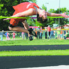 St. Anthony's John Goeckner clears the bar in the high jump during a meet last May.