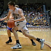 Teutopolis' Cody Will drives to the basket while being trailed by a Bulldog defender.