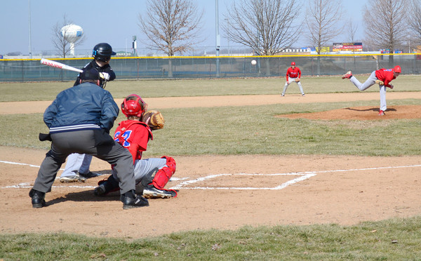 St. Anthony's Zach Gardewine delivers a pitch to Cumberland's Sam Bauguss in the first game of a round robin at Evergreen Park in Effingham.