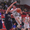 Teutopolis' Cody Will takes it to the rim with Breese Central's Jacob Timmermann defending him.