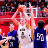 Teutopolis' Brett Mette goes for a jump shot while Breese Central's Kenton Roeckenhaus (50) attempts to defend during the Class 2A Vandalia Sectional.