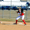 Effingham's Brittany Beals awaits an incoming pickoff throw while Springfield Sacred Heart Griffin's Katie McLean slides back into first base.