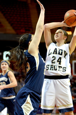 Teutopolis' Haley Giles takes a jump shot over Elmhurst Immaculate Conception's Anjella Farmer during the Class 2A third-place game.