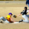 Brownstown/St. Elmo's Dalton Parks slides safely into third on a stolen base attempt while Ramsey third baseman Devon Mercer attempts to apply the tag.