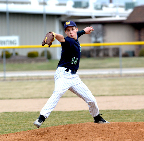 Windsor/Stew-Stras' Nic Hutchinson goes through his delivery against Teutopolis.