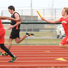 Effingham's Marcus Robinson takes the baton from Tristen Rhodes during the 4x100m relay.