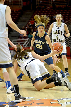 Teutopolis' Madeline Hartke dives for a loose ball and looks to pass to Jessica Schumacher (4) during the Class 2A third-place game against Elmhurst Immaculate Conception.