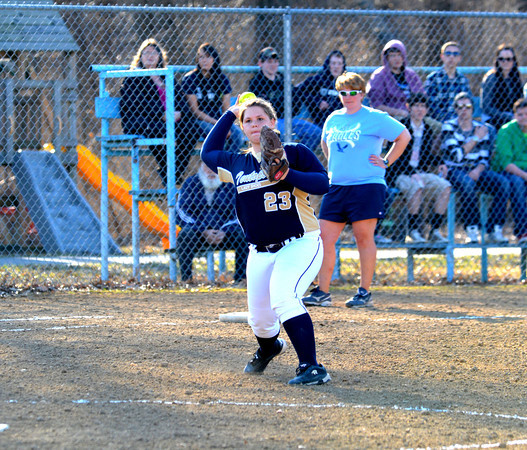 Teutopolis third baseman Allison Apke fires a throw across the diamond in a 20-10 win over St. Elmo/Brownstown.
