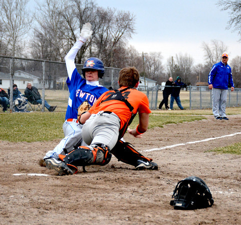 Newton's Mike Carr slides into home and is tagged out by Altamont's Dalton Ricketts in both teams' season openers.