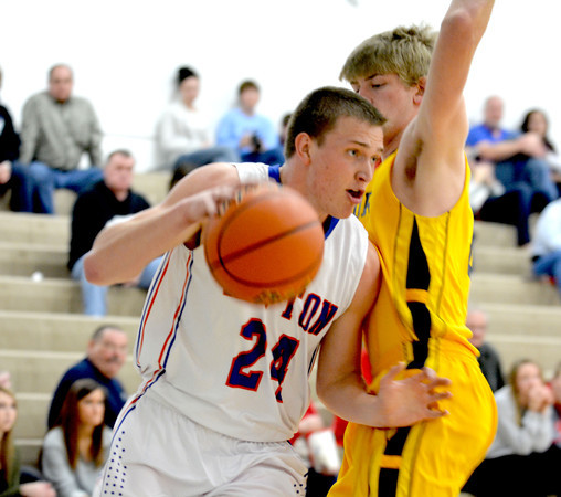 Newton's Luke Stone posts up Windsor's Alex Allen during the Central Illinois All-Star game at Cumberland High School.