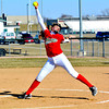 Effignham pitcher Hope Collier reaches the apex of her delivery during the Flaming Hearts' loss to Sacred Heart Griffin.
