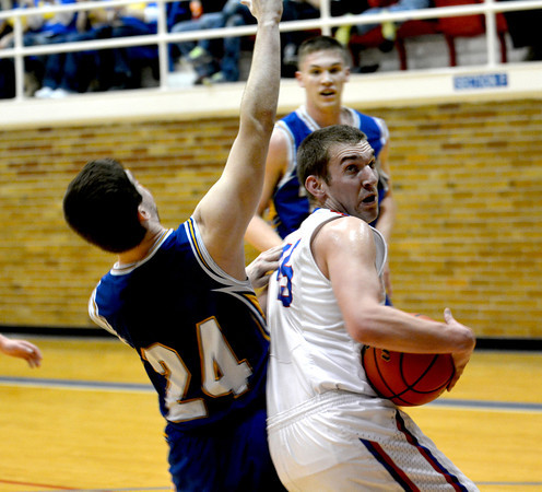 St. Anthony's John Goeckner spins around the defense of Oblong's Kyler Fear at the Class 1A Red Hill Sectional.