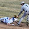 3-31-15<br /> Kokomo vs Eastern baseball<br /> Eastern's Jacob Hartman tas Kokomo's S.A. Dunn out between second and third base.<br /> Kelly Lafferty Gerber | Kokomo Tribune