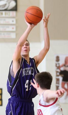 3-6-15<br /> Northwestern vs Twin Lakes<br /> Northwestern's Tyler Hudson shoots.<br /> Kelly Lafferty Gerber | Kokomo Tribune