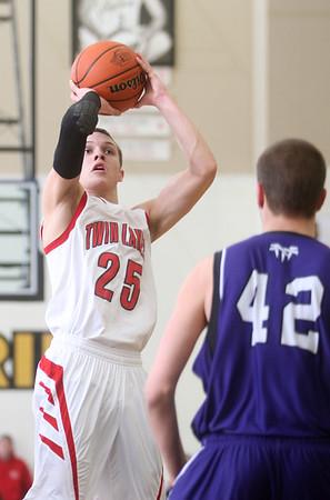 3-6-15<br /> Northwestern vs Twin Lakes<br /> Twin Lakes' Blake Bennington looks to the basket for a shot.<br /> Kelly Lafferty Gerber   Kokomo Tribune