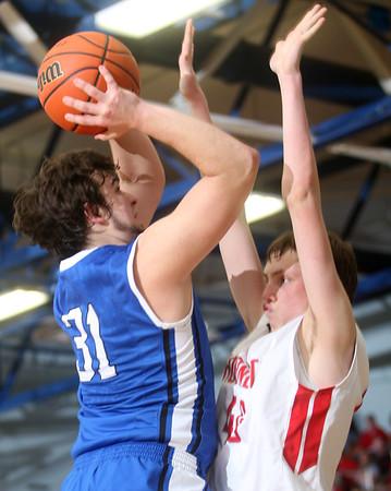 3-7-15<br /> Carroll vs Rossville<br /> Carroll's Jared Miller shoots over Rossville's Clayton Howard.<br /> Kelly Lafferty Gerber | Kokomo Tribune