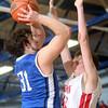 3-7-15<br /> Carroll vs Rossville<br /> Carroll's Jared Miller shoots over Rossville's Clayton Howard.<br /> Kelly Lafferty Gerber   Kokomo Tribune