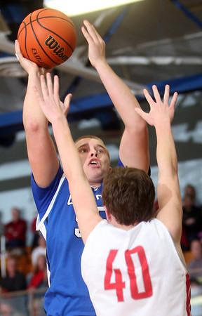3-7-15<br /> Carroll vs Rossville<br /> Carroll's Jarin Bush shoots over Rossville's Clayton Howard.<br /> Kelly Lafferty Gerber | Kokomo Tribune