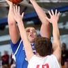 3-7-15<br /> Carroll vs Rossville<br /> Carroll's Jarin Bush shoots over Rossville's Clayton Howard.<br /> Kelly Lafferty Gerber   Kokomo Tribune