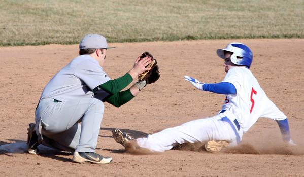 3-31-15<br /> Kokomo vs Eastern baseball<br /> Kokomo's Jared Dill slides into second safely before Eastern's Alec Downing can get him out.<br /> Kelly Lafferty Gerber | Kokomo Tribune