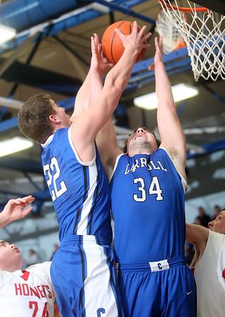 3-7-15<br /> Carroll vs Rossville<br /> Carroll's Adam Beaver and Brandon Dillon go up for a rebound.<br /> Kelly Lafferty Gerber | Kokomo Tribune