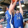3-7-15<br /> Carroll vs Rossville<br /> Carroll's Adam Beaver and Brandon Dillon go up for a rebound.<br /> Kelly Lafferty Gerber   Kokomo Tribune