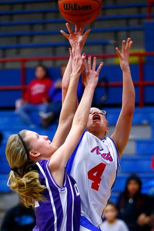 Eighth grade girls basketball city/county championship between Northwestern and Kokomo on Monday March 23, 2015. Northwestern's Kaylee Watson blocking and fouling Kokomo's Olivia Eddington.<br /> Tim Bath | Kokomo Tribune