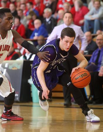 3-6-15<br /> Northwestern vs Twin Lakes<br /> Northwestern's Blake Oakley dribbles toward the basket.<br /> Kelly Lafferty Gerber | Kokomo Tribune