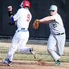 3-31-15<br /> Kokomo vs Eastern baseball<br /> Eastern's Taylor Tattersall tags Kokomo's Nate Hemmerich.<br /> Kelly Lafferty Gerber | Kokomo Tribune