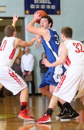 3-7-15<br /> Carroll vs Rossville<br /> Carroll's Brandon Dillon looks for a pass around Rossville's defense.<br /> Kelly Lafferty Gerber | Kokomo Tribune