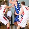 3-7-15<br /> Carroll vs Rossville<br /> Carroll's Brandon Dillon looks for a pass around Rossville's defense.<br /> Kelly Lafferty Gerber   Kokomo Tribune