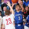 3-7-15<br /> Carroll vs Rossville<br /> Carroll's Jarrett Gish shoots.<br /> Kelly Lafferty Gerber   Kokomo Tribune