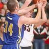 3-3-15<br /> Tri Central vs Clinton Prairie basketball<br /> Tri Central's Bryce Dowell tries to take the ball away from Clinton Prairie's Chase Joseph.<br /> Kelly Lafferty Gerber | Kokomo Tribune