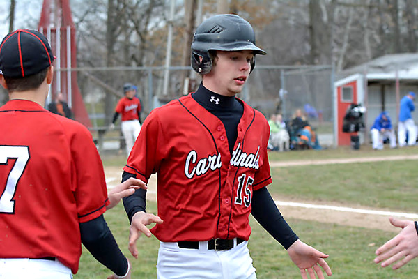 North Clay's Austin Stinnett celebrates with teammates after hitting a two-run home run in the first inning of the Cardinals' 12-1 win against Red Hill in the first game of the season.