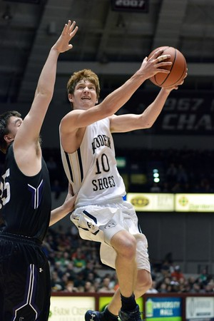Teutopolis' Devin Smith soars to the basket and is defended by Breese Central's Chase Schneider during Teutopolis' Super-Sectional loss to Breese Central at Southern Illinois University.