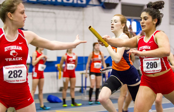 Effingham's Kristina Rivera hands off to Shayna Phillips during a relay at the EIU indoor invite.