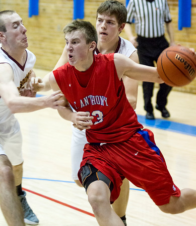 St. Anthony's Drew Gibson drives the baseline during a sectional semifinal against Dieterich at Red Hill.
