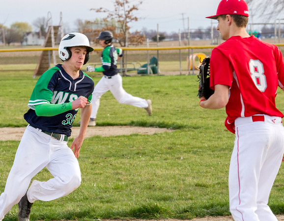 Windsor/Stew-Stras' Josh Overbeck rounds third base during the bottom of the fifth inning. The Hatchets held off Marshall to win 7-6.