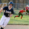 Teutopolis' Anni Borries rounds second base after launching a deep triple to left field against Sullivan.