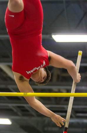 Effingham's Drew Vasquez clears his height during the pole vault at EIU. Vasquez would finish in seventh place after reaching 12 feet.