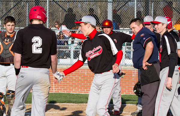 Effingham's Lane Koenig (2, left) is welcomed at home plate by Michael Woltman (helmet, center) and the rest of the Effingham baseball team after his 3-run walk-off homer in the bottom of the seventh against Altamont.