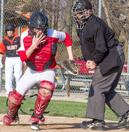 St. Anthony's Bryar Jansen scrambles to find a passed ball during a game against Olney.