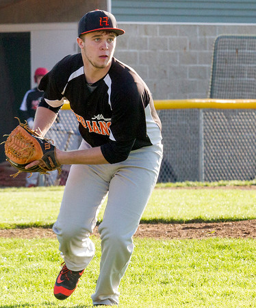 Altamont pitcher Klaiton Wolff eyes first base before making the putout at first against Effingham.