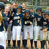 Teutopolis' softball team welcomes Allison Apke (23) at home plate after her grand slam in the sixth inning against Charleston.
