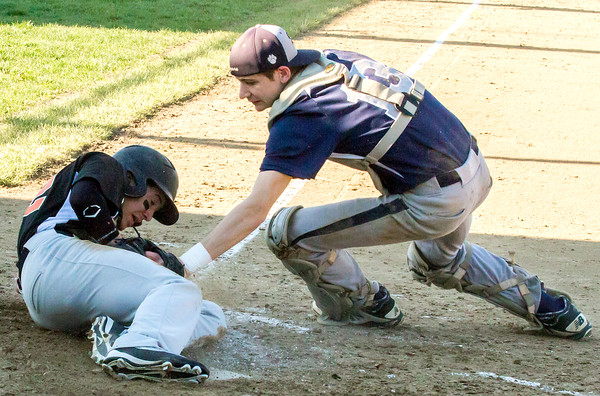 Altamont's Nick Miller is tagged by South Central catcher Brett Harmeier, but was ruled safe on the play.