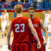 St. Anthony's Kyle Hartke (right) reacts to Nick Grunloh's steal and putback late in the fourth quarter at the Class 1A Red Hill Sectional.