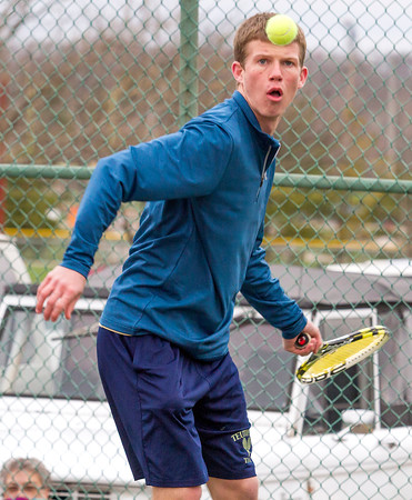 Teutopolis' Jacob Mette eyes the ball prior to his swing during a doubles match against Charleston. He and teammate Trevor Lee beat Brock Esarey and Andrew Tresslar 6-1, 6-3 in a 9-0 win over the Trojans.