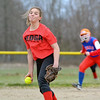 Neoga's Elizabeth Titus releases a pitch as Cowden-Herrick/Beecher City's Sarah Kirchhofer (background) begins to take her lead off second base in Beecher City.